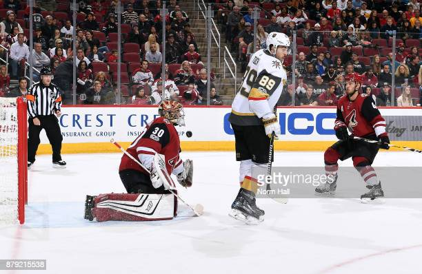 Alex Tuch of the Vegas Golden Knights tries to redirect the puck past goalie Marek Langhamer of the Arizona Coyotes during the third period at Gila...