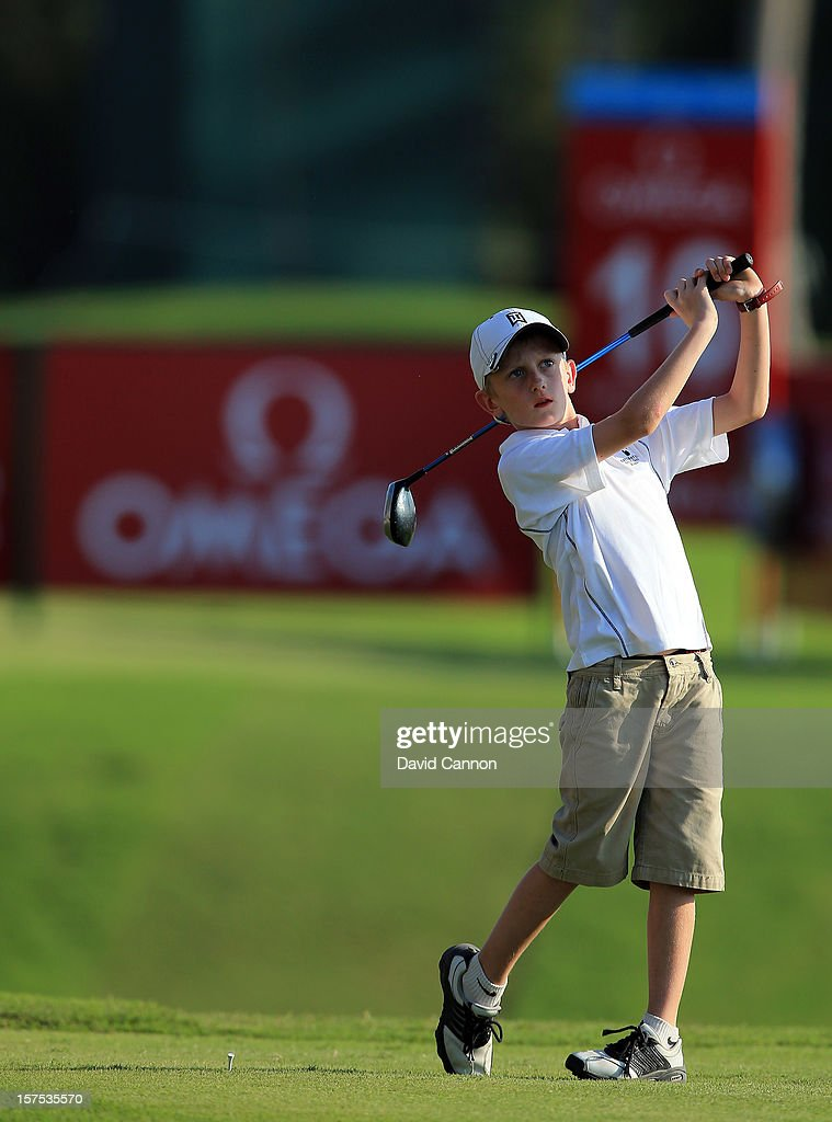 Alex Turlik at eight years old the youngest player in the pro-am plays his tee shot at the par 4, 16th hole during the pro-am as a preview for the 2012 Omega Dubai Ladies Masters on the Majilis Course at the Emirates Golf Club on December 4, 2012 in Dubai, United Arab Emirates.