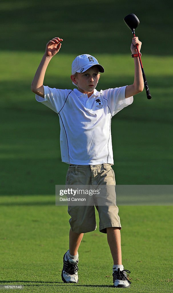 Alex Turlik at eight years old the youngest player in the pro-am reacts to his third shot at the par 4, 16th hole during the pro-am as a preview for the 2012 Omega Dubai Ladies Masters on the Majilis Course at the Emirates Golf Club on December 4, 2012 in Dubai, United Arab Emirates.
