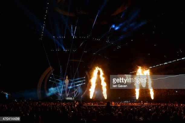 Alex Turner Jamie Cook Nick O'Malley and Matt Helders of Arctic Monkeys perform at The BRIT Awards 2014 at 02 Arena on February 19 2014 in London...