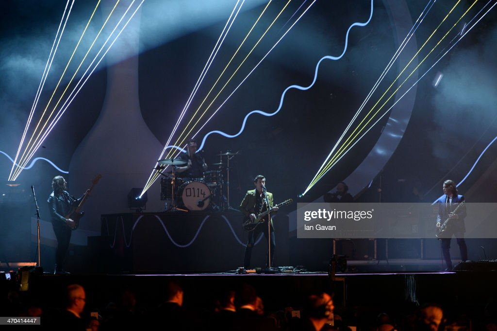 Alex Turner, Jamie Cook, Nick O'Malley and Matt Helders of <a gi-track='captionPersonalityLinkClicked' href=/galleries/search?phrase=Arctic+Monkeys&family=editorial&specificpeople=274715 ng-click='$event.stopPropagation()'>Arctic Monkeys</a> perform at The BRIT Awards 2014 at 02 Arena on February 19, 2014 in London, England.