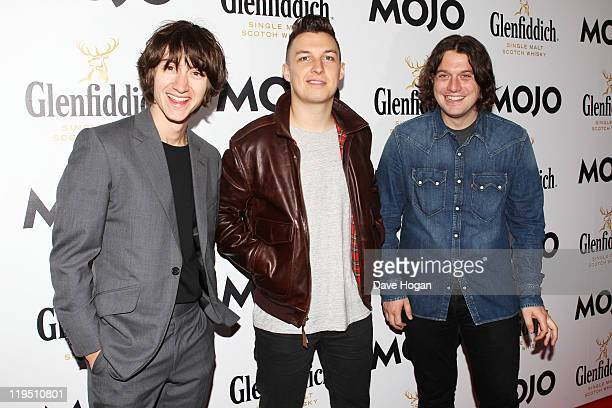 Alex Turner Matt Helders and Nick O'Malley of The Arctic Monkeys attend the Glenfiddich Mojo Honours List 2011 at The Brewery on July 21 2011 in...