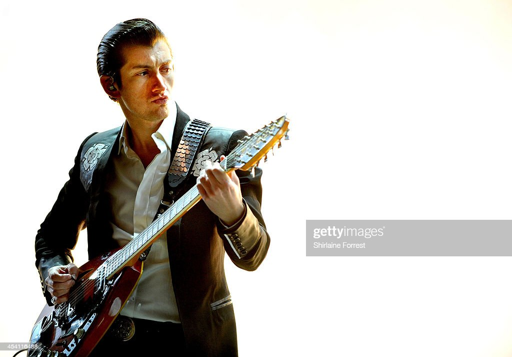 <a gi-track='captionPersonalityLinkClicked' href=/galleries/search?phrase=Alex+Turner&family=editorial&specificpeople=706618 ng-click='$event.stopPropagation()'>Alex Turner</a> of Arctic Monkeys performs headlining Day 3 of the Leeds Festival at Bramham Park on August 24, 2014 in Leeds, England.