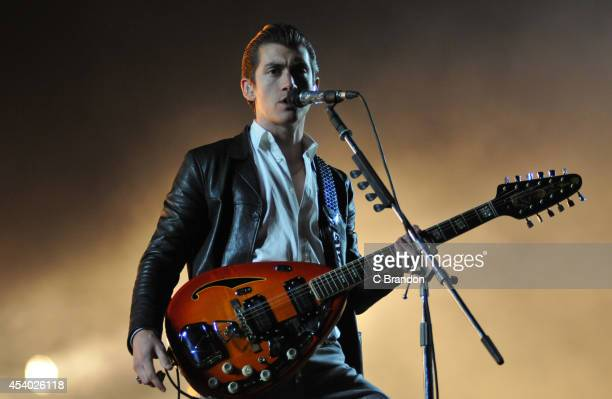 Alex Turner of Artic Monkeys performs on stage at the Reading Festival at Richfield Avenue on August 23 2014 in Reading United Kingdom