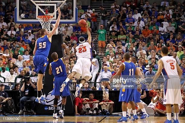 Alex Tyus of the Florida Gators drives for a shot attempt against Greg Somogyi of the UC Santa Barbara Gauchos during the second round of the 2011...