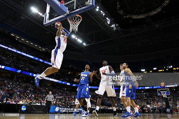 Alex Tyus of the Florida Gators dunks against the UC Santa Barbara Gauchos during the second round of the 2011 NCAA men's basketball tournament at St...