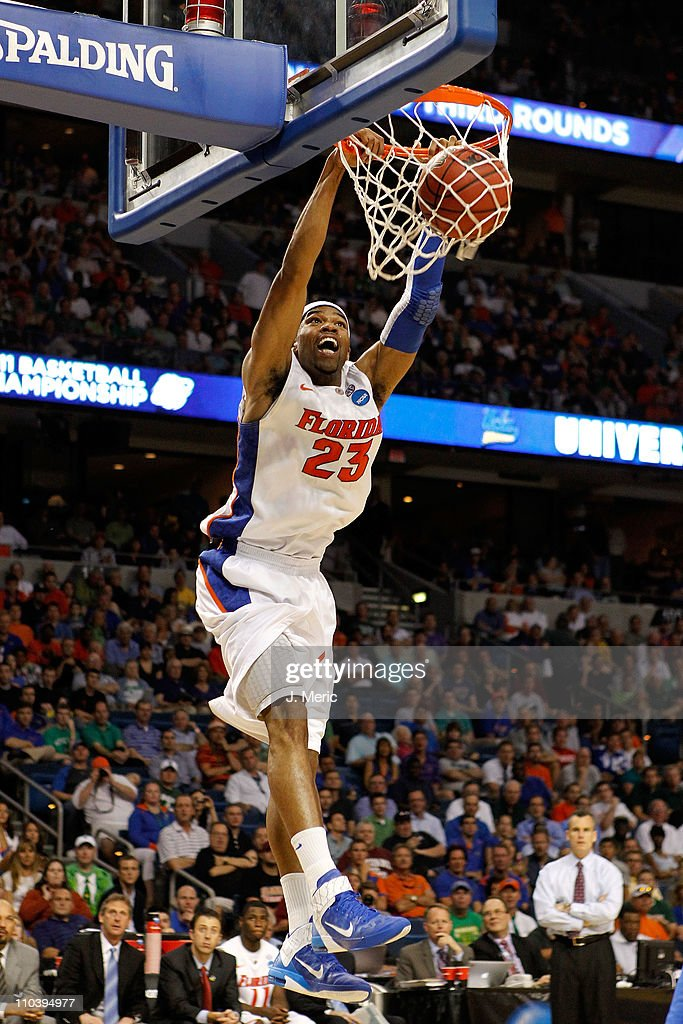Alex Tyus #23 of the Florida Gators dunks against the UC Santa Barbara Gauchos during the second round of the 2011 NCAA men's basketball tournament at St. Pete Times Forum on March 17, 2011 in Tampa, Florida.