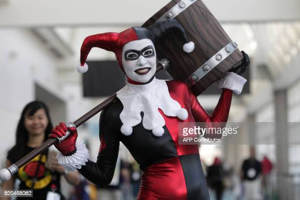 Alex Waldron plays the part of Harley Quinn from the movie Suicide Squad during ComicCon 2017 in San Diego California July 21 2017 / AFP PHOTO / Bill...