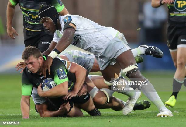 Alex Waller of Northampton is tackled by Maro Itoje during the European Rugby Champions Cup match between Northampton Saints and Saracens at...