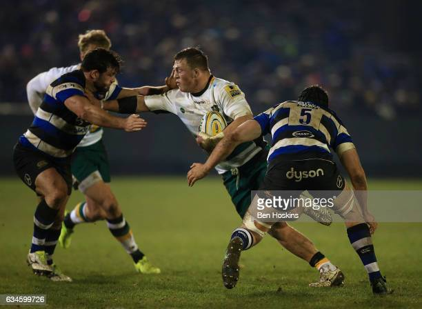 Alex Waller of Northampton is tackled by Nathan Catt and Charlie Ewels of Bath during the Aviva Premiership match between Bath Rugby and Northampton...