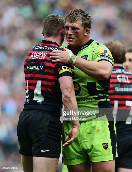 Alex Waller of Northampton Saints commiserates with Chris Ashton of Saracens following the Aviva Premiership Final between Saracens and Northampton...
