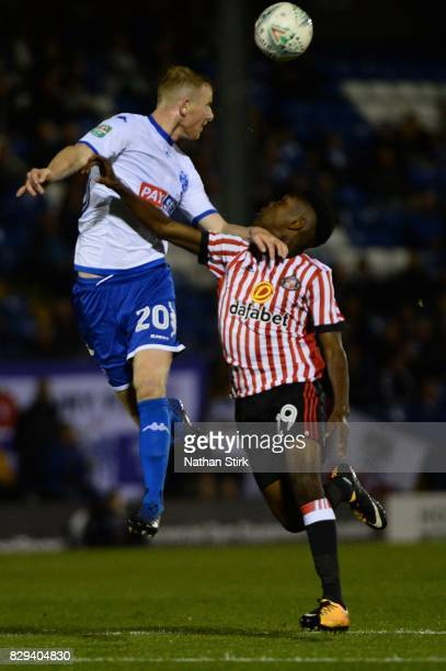 Alex Whitmore of Bury and Joel Asoro of Sunderland compete for the ball during the Carabao Cup First Round match between Bury and Sunderland at Gigg...