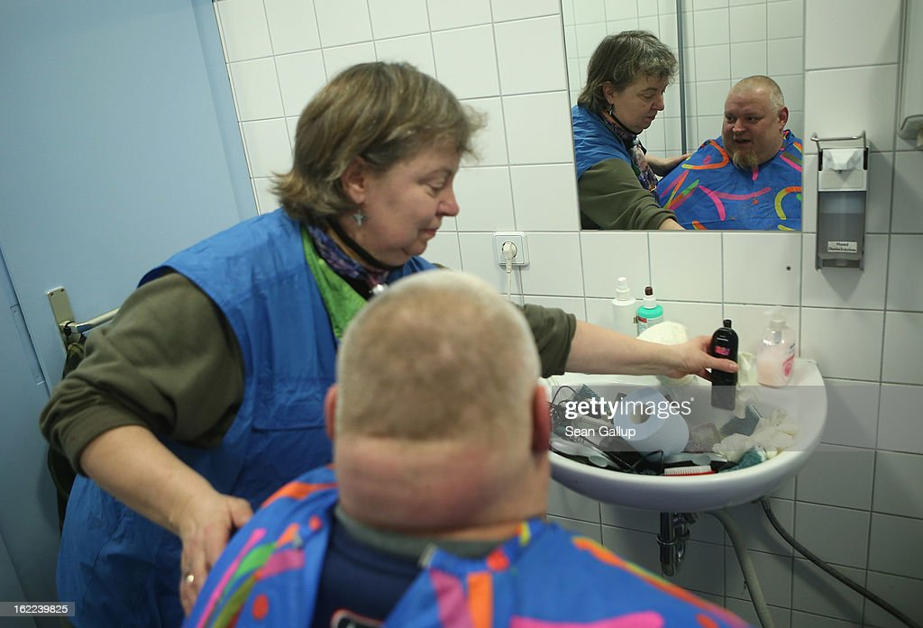 Alex, who is homeless, gets a free haircut from Franziska in a bathroom after having a free lunch at the Bahnhofsmission Protestant charity facility at Zoo train station on February 20, 2013 in Berlin, Germany. The Bahnhofsmission feeds up to 600 needy men and women every day, up from 400 only three years ago. Approximately 60% of the visitors are from Eastern Europe, many of them workers in low-paying jobs who became unemployed and ran out of money. Dieter Puhl, who runs the Bahnhofsmission, says he is seeing a steady increase in the number of visitors, especially among older Germans whose pensions are insufficient for them to make ends meet. Poverty in Germany, defined as someone who makes less than 60% of the median wage, has risen steadily in recent years, and according to statistics 14% of people in Germany lived below the poverty line in 2010. Both poverty and pensions that have not kept up with the rising cost of living will be contested topics in federal elections scheduled later for this year.
