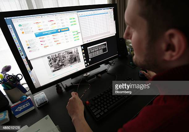 Alex Wilhelm a bitcoin miner uses his computer that is set up to mine the cryptocurrency at his home in Tokyo Japan on Saturday March 29 2014 Wilhelm...