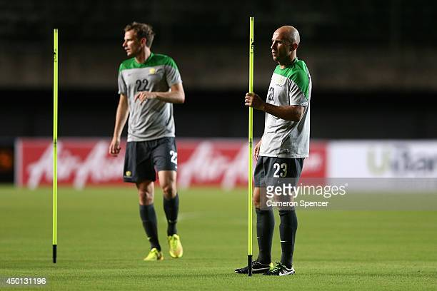 Alex Wilkinson and Mark Bresciano of the Socceroos prepare for a drill during an Australian Socceroos training session at Pituacu Stadium on June 5...