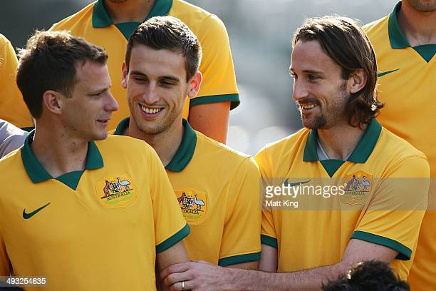 Alex Wilkinson Matthew Spiranovic and Josh Kennedy line up for the team photo during the Australian Socceroos World Cup Squad official team photo...