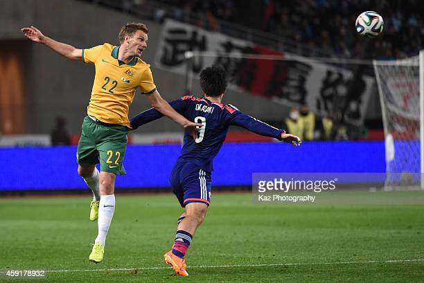 Alex Wilkinson of Australia and Shinji Okazaki of Japan compete for the ball during the international friendly match between Japan and Australia at...