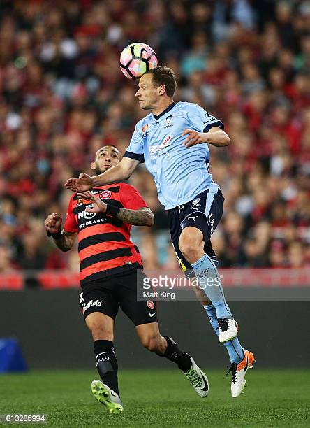 Alex Wilkinson of Sydney FC heads the ball during the round one ALeague match between the Western Sydney Wanderers and Sydney FC at ANZ Stadium on...