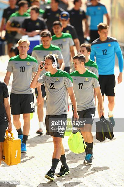Alex Wilkinson of the Socceroos and team mates arrive at an Australian Socceroos training session and press conference at Arena Unimed Sicoob on June...