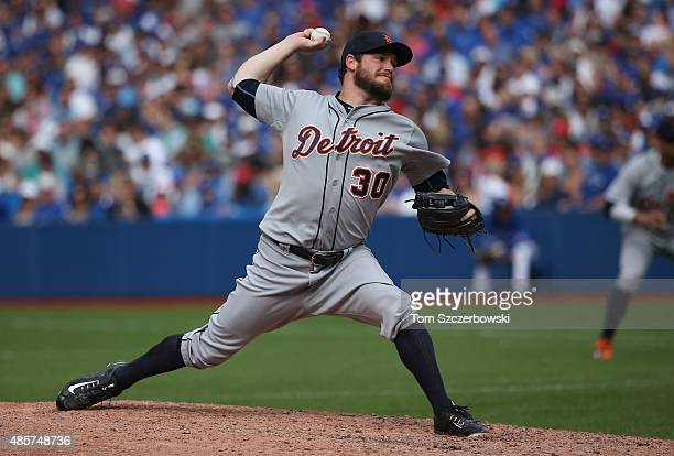 Alex Wilson of the Detroit Tigers delivers a pitch in the seventh inning during MLB game action against the Toronto Blue Jays on August 29 2015 at...