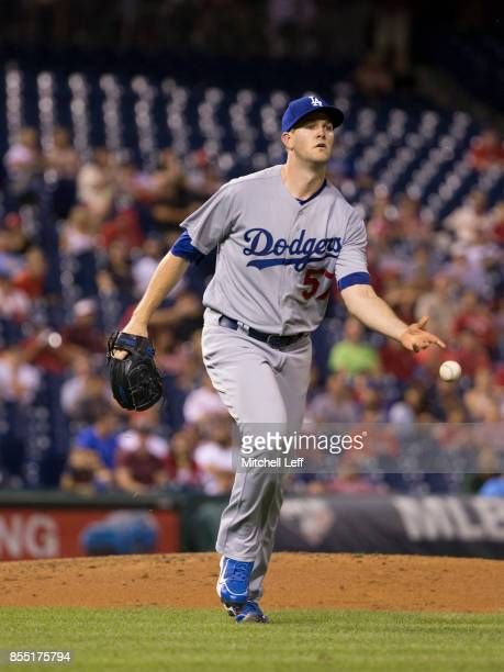 Alex Wood of the Los Angeles Dodgers flips the ball to first base against the Philadelphia Phillies at Citizens Bank Park on September 20 2017 in...