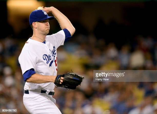 Alex Wood of the Los Angeles Dodgers makes a throw to first on a bunt single from Gregor Blanco of the Arizona Diamondbacks during the sixth inning...