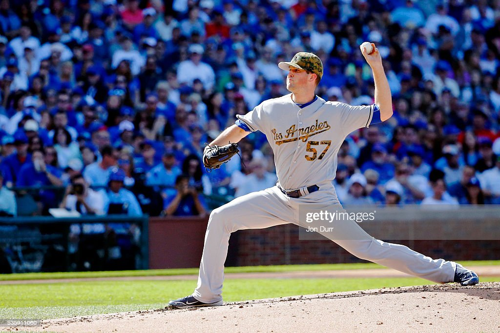 <a gi-track='captionPersonalityLinkClicked' href=/galleries/search?phrase=Alex+Wood+-+Baseball+Player&family=editorial&specificpeople=12544108 ng-click='$event.stopPropagation()'>Alex Wood</a> #57 of the Los Angeles Dodgers pitches against the Chicago Cubs during the first inning at Wrigley Field on May 30, 2016 in Chicago, Illinois.