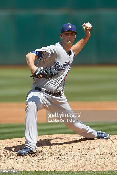 Alex Wood of the Los Angeles Dodgers pitches in the second inning of an interleague game against the Oakland Athletics at Oco Coliseum on August 19...