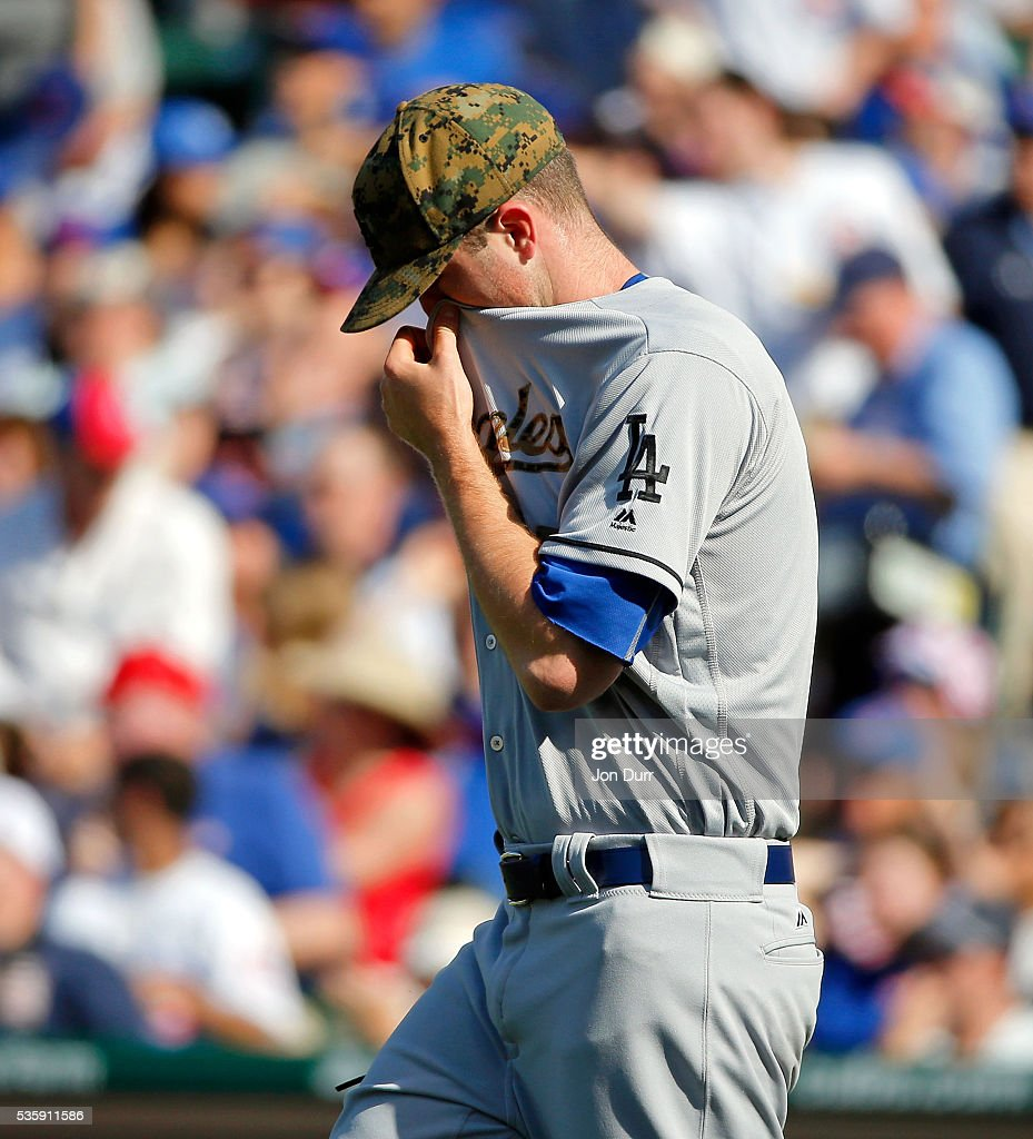 <a gi-track='captionPersonalityLinkClicked' href=/galleries/search?phrase=Alex+Wood+-+Baseball+Player&family=editorial&specificpeople=12544108 ng-click='$event.stopPropagation()'>Alex Wood</a> #57 of the Los Angeles Dodgers reacts after giving up a bunt to Javier Baez #9 of the Chicago Cubs (not pictured) during the second inning at Wrigley Field on May 30, 2016 in Chicago, Illinois.