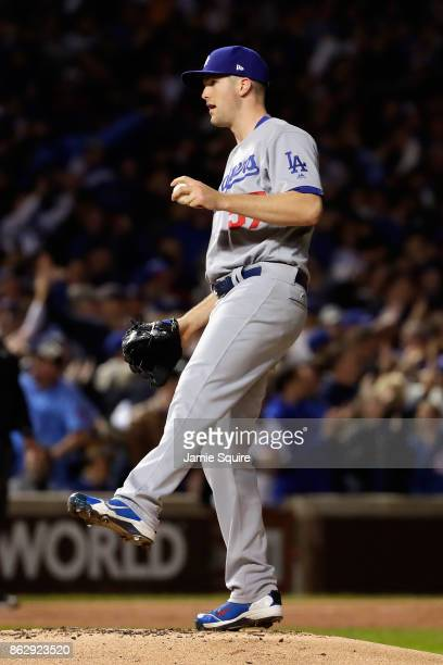 Alex Wood of the Los Angeles Dodgers reacts after giving up a home run to Willson Contreras of the Chicago Cubs in the second inning during game four...