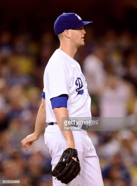 Alex Wood of the Los Angeles Dodgers reacts to a gand slam homerun by pitcher Jaime Garcia of the Atlanta Braves for a 90 Braves lead during the...