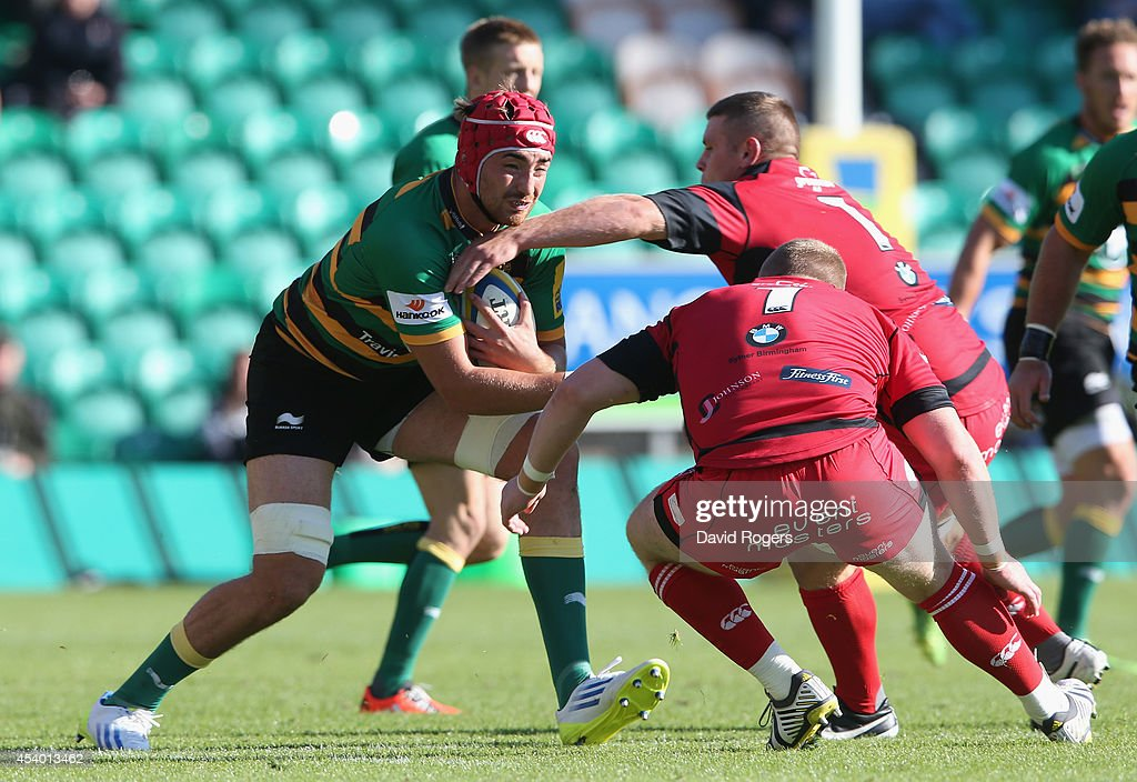 Alex Woolford of Northampton charges upfield during the pre season friendly match between Northampton Saints and Moseley at Franklin's Gardens on August 23, 2014 in Northampton, England.