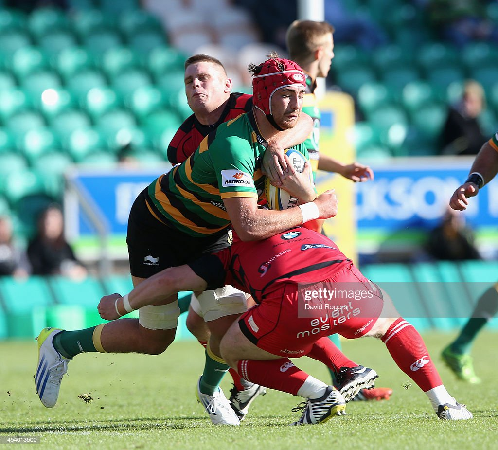 Alex Woolford of Northampton is tackled during the pre season friendly match between Northampton Saints and Moseley at Franklin's Gardens on August 23, 2014 in Northampton, England.