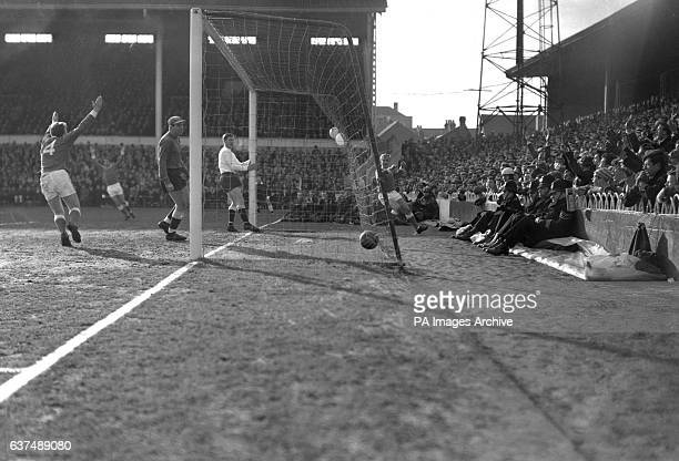Alex Young the Everton forward scores their first goal against Tottenham Hotspur Also pictured is Tottenham goalkeeper John Hollowbread and Maurice...