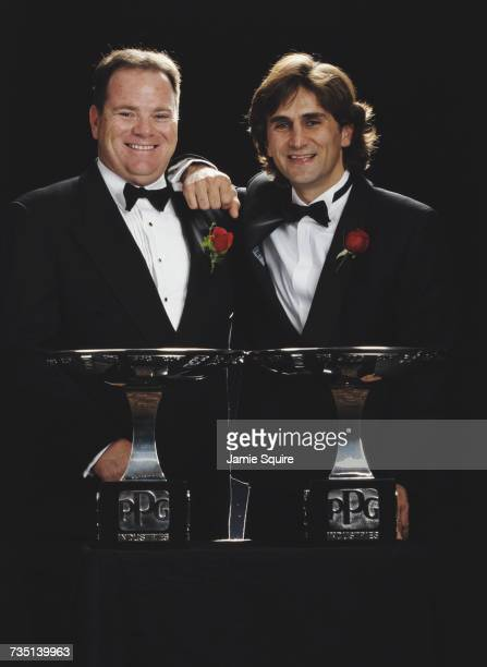 Alex Zanardi of Italy driver of the Target Ganassi Racing Reynard 98i Honda stands with team owner Chip Ganassi and the Drivers' Champion Trophy...