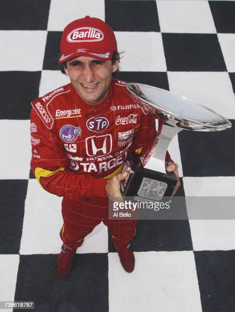 Alex Zanardi of Italy driver of the Target Ganassi Racing Reynard 98i Honda poses for a portrait holding his PPG Industries Championship Trophy...