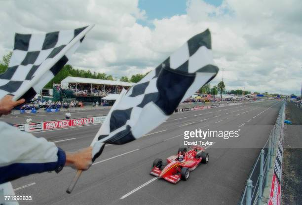 Alex Zanardi of Italy driving the Target Ganassi Racing Reynard 96i Honda takes the chequered flag to win the Championship Auto Racing Teams 1996 PPG...