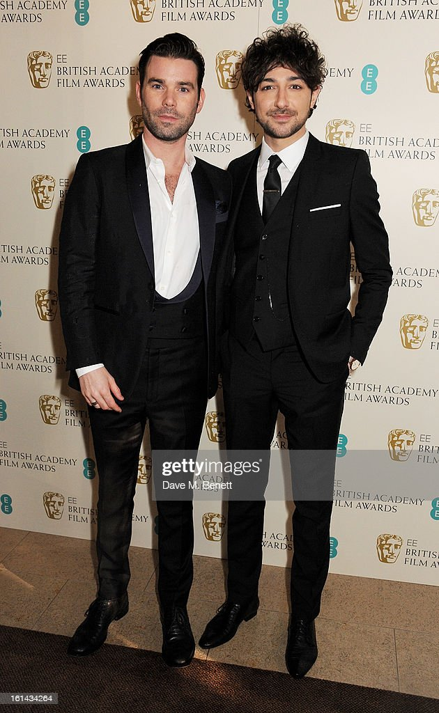 Alex Zane (R) and guest arrive at the EE British Academy Film Awards at the Royal Opera House on February 10, 2013 in London, England.