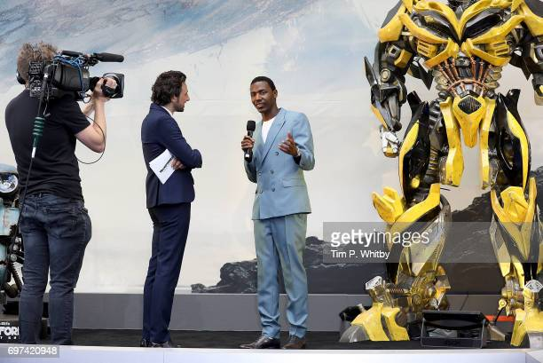 Alex Zane and Jerrod Carmichael on stage at the global premiere of 'Transformers The Last Knight' at Cineworld Leicester Square on June 18 2017 in...