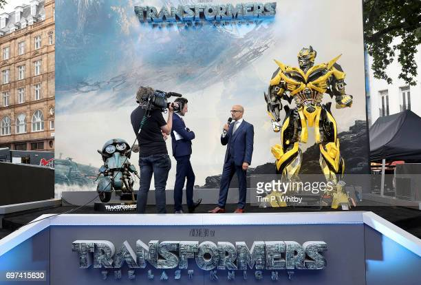 Alex Zane and Stanley Tucci on stage at the global premiere of 'Transformers The Last Knight' at Cineworld Leicester Square on June 18 2017 in London...