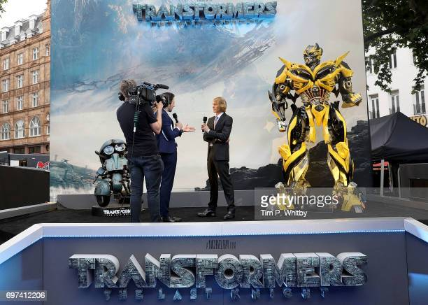 Alex Zane interviews Michael Bay on stage at the global premiere of 'Transformers The Last Knight' at Cineworld Leicester Square on June 18 2017 in...