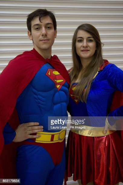 Alex Zaris as Superman and Artmis Pantelides as Superwoman attend the London Super Comic Convention 2014 Excel Centre east London