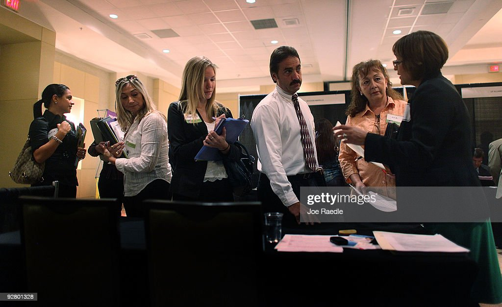 Alexa Besner, (L-R) Cristina Carrilla, Stephanie Stanford, Peter Hardy and Luz Valasquez speak with Diane-Brito Wigfall as she recruits workers for Talent Tree at a job fair put on by Monster.com on November 5, 2009 in Fort Lauderdale, Florida. The Monster's 'Keep America Working Tour', is helping workers find jobs as the US employment report for October, which comes out tomorrow, is expected to show that the jobless rate stayed close to a 26-year high of 9.8 per cent in September.