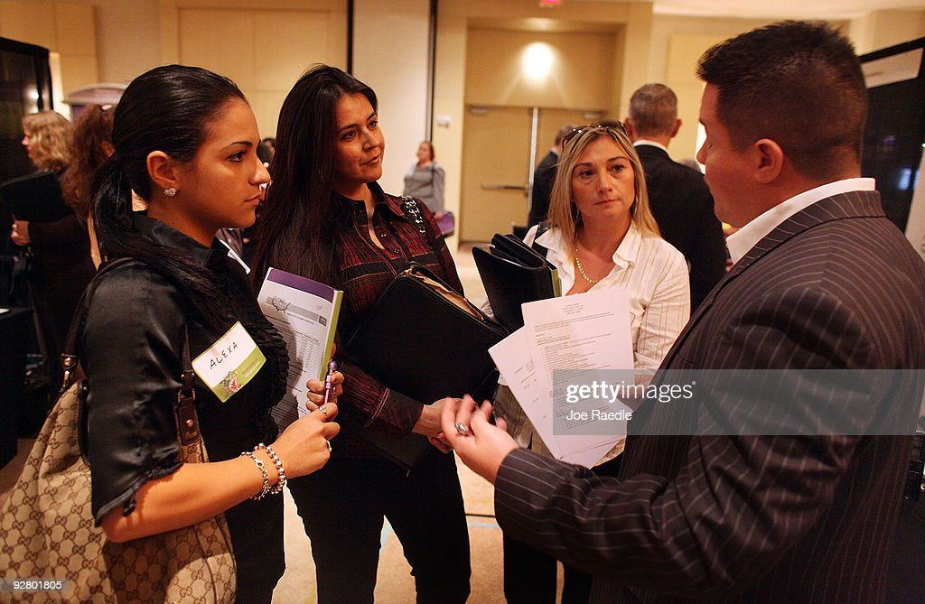 Alexa Besner, (L-R) Patricia Villarreal and Cristina Carrilla, speak with Mauricio Banderas as he recruits workers for United First Financial at a job fair put on by Monster.com on November 5, 2009 in Fort Lauderdale, Florida. The Monster's 'Keep America Working Tour', is helping workers find jobs as the US employment report for October, which comes out tomorrow, is expected to show that the jobless rate stayed close to a 26-year high of 9.8 per cent in September.