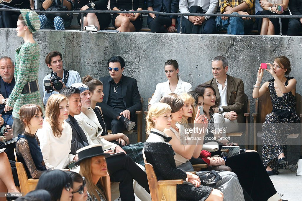 Alexa Chung, Amber Anderson, Michael Pitt , Kristen Stewart, Olivier Assayas, Rose Byrne, Clemence Poesy, Milla Jovovich and Arielle Dombasle attend the Chanel show as part of Paris Fashion Week Haute-Couture Fall/Winter 2013-2014 at Grand Palais on July 2, 2013 in Paris, France.