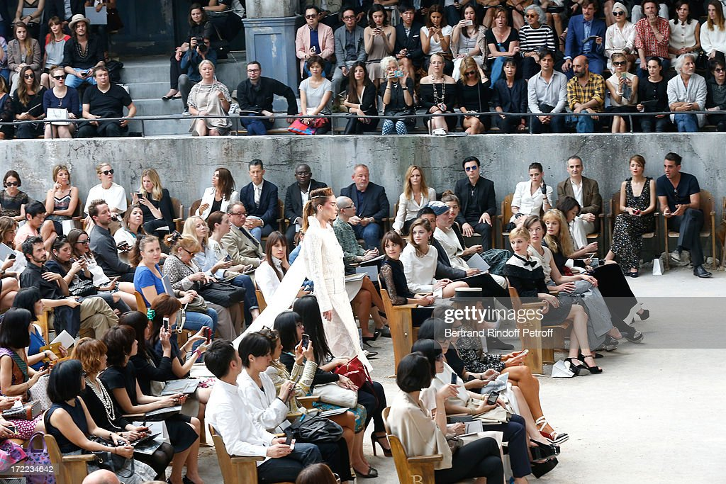 Alexa Chung, Amber Anderson, Vanessa Paradis, Michael Pitt , Kristen Stewart, Olivier Assayas, Rose Byrne with her companion Bobby Cannavale, Clemence Poesy, Milla Jovovich and Arielle Dombasle attend the Chanel show as part of Paris Fashion Week Haute-Couture Fall/Winter 2013-2014 at Grand Palais on July 2, 2013 in Paris, France.