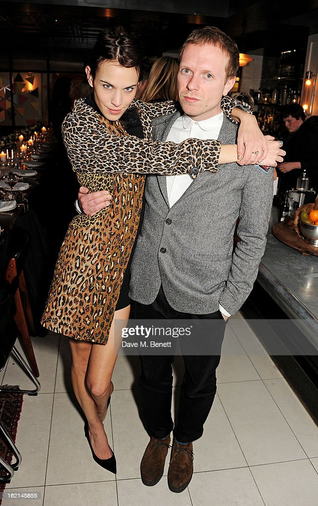 Alexa Chung (L) and Alex Miller attend as Nick Grimshaw hosts his first annual award season dinner at Hix, in association with Philips Sound, on February 19, 2013 in London, England.