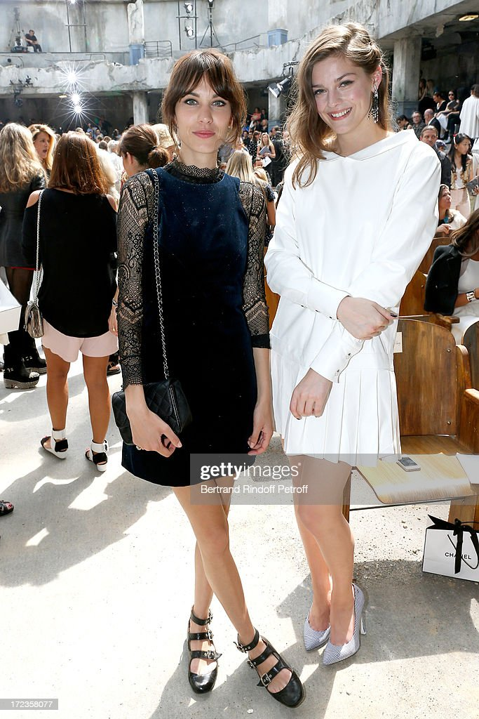 Alexa Chung and Amber Anderson attend the Chanel show as part of Paris Fashion Week Haute-Couture Fall/Winter 2013-2014 at Grand Palais on July 2, 2013 in Paris, France.