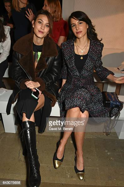 Alexa Chung and Caroline Sieber attend the ERDEM show during the London Fashion Week February 2017 collections at the Old Selfridges Hotel on...