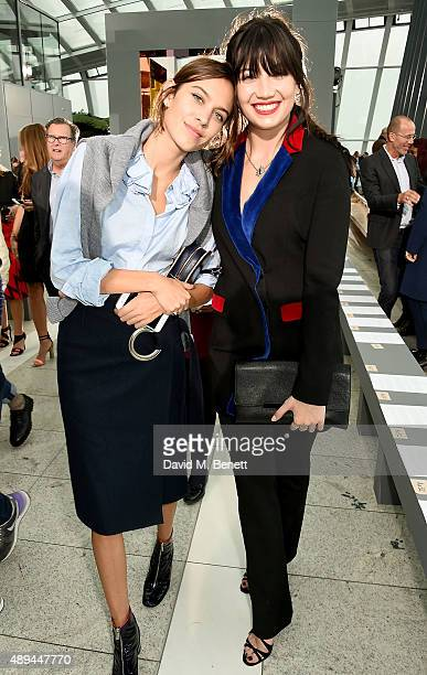 Alexa Chung and Daisy Lowe attend the Christopher Kane show during London Fashion Week SS16 at Sky Garden on September 21 2015 in London England